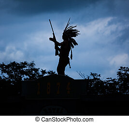 Silhouette of American Indian warrior man with feather...