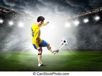 soccer player - soccer or football player is kicking ball on...