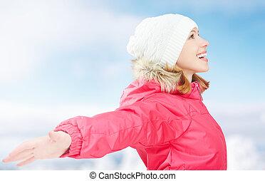 Winter activities in nature. happy girl with open hands...