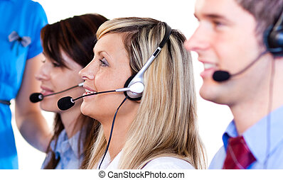 Team of people talking with headsets on - Team of people...