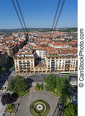 View of roofs from Getxo from Bizkaia suspension bridge -...