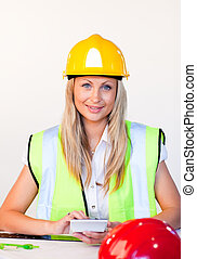Portrait of blonde woman with hard hat on