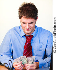 Businessperson with money - Male businessperson holding...