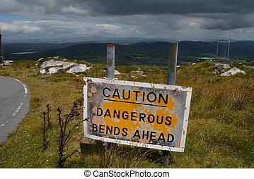 Caution Dangerous Bends Ahead - Dangerous bends sign on...