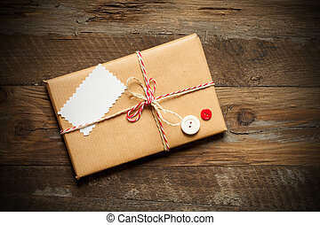 parcel wrapped packaged box on wood background