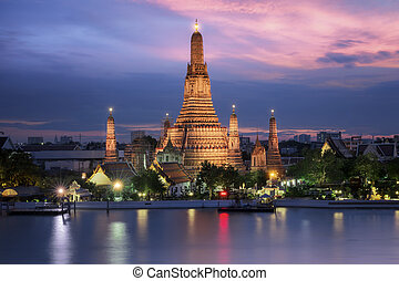 wat arun in sunset with pink sky