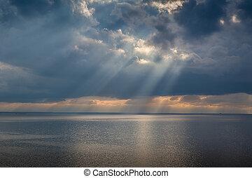 Sun rays and heavy sky - Sun beam through heavy sky over...