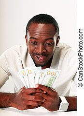 Portrait of a happy african man holding US dollars