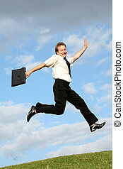businessman jumps - happy businessman with bag jumps in the...