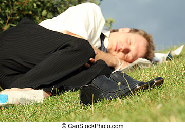 businessman sleeping in park - jobless businessman sleeping...