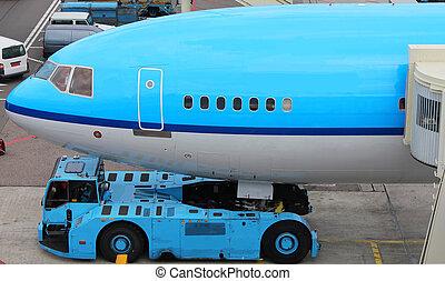 plane push back - plane pushed back at gate