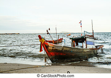 Small fishing boats on the beach Thailand