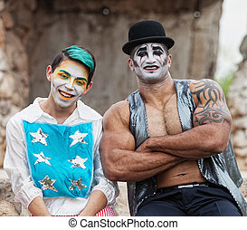 Strong Man with Cirque Clown - Laughing clown with stars and...