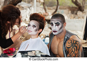Clowns Getting Makeup - Makeup artist working clown eyeliner...