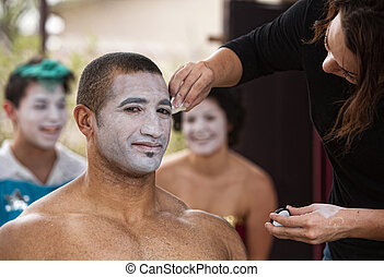 Young Performer Getting Makeup - Handsome young...