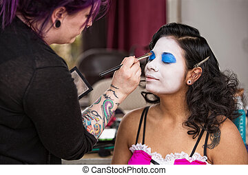 Pretty Clown Getting Eye Shadow - Young beautiful clown...