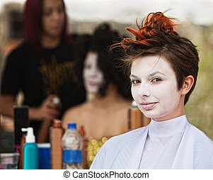Calm Woman in White Makeup - Young female actress in white...
