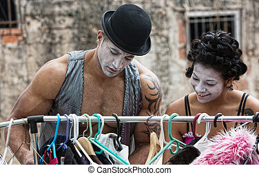 Cirque Clown - Two cirque clowns choosing costumes at...