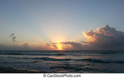 Carribbean sunset in Cancun - Caribbean sunset at a beach on...