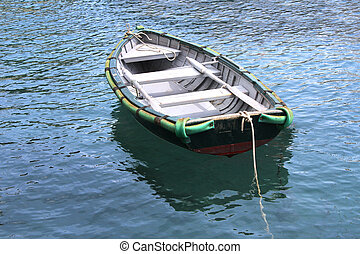 Old Wooden ship - Small wooden boat, docked in the port of...