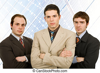 team - three business man standing at the office