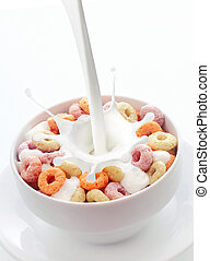 Bowl of colorful fruit loops breakfast cereal - Pouring...