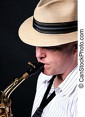 Saxophone Jazz Player on Black - A professional jazz...