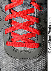 Red Shoe Laces on Running Shoes - Detail of red shoe laces...