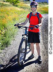 Woman Mountain Biking Wearing Red Shirt