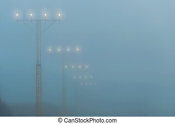 Landing lights at a airport during foggy weahter, help...