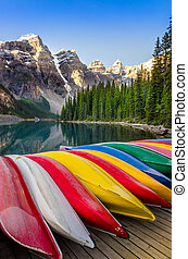 Landscape view of Moraine lake with colorful boats, Rocky...