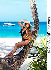 a beautiful young woman with long hair in a straw hat...