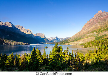 Scenic view of mountain range in Glacier NP, Montana -...