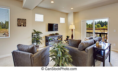 Bright beautiful  living room with walkout deck.