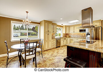 Kitchen interior with dining table set and island - Spacious...