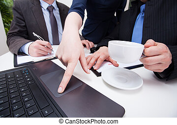 Female hand pointing on notebook