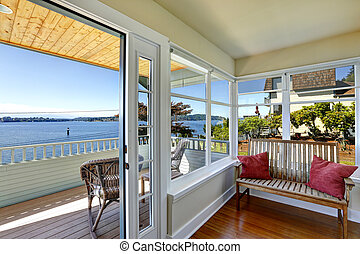 Sun room and walkout deck. American architecture. Real estate wi