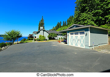 House with water front view, large driveway and garage Port...