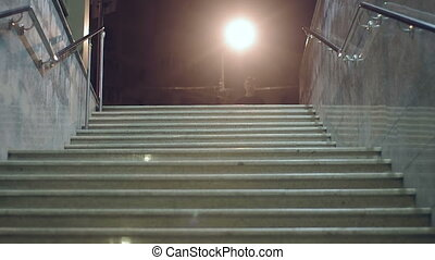 descend stairs - a man descends some stairs