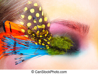 Woman with fashion feather eyelashes make-up - Woman with...