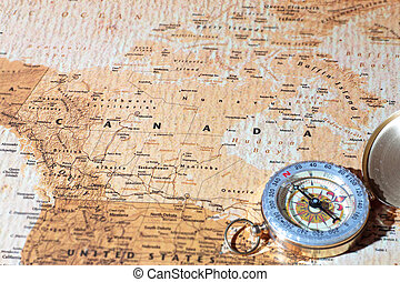 Travel destination Canada, ancient map with vintage compass...