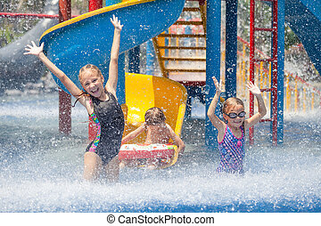 three little kids playing in the swimming pool