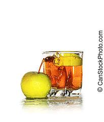 Apple Juice - Green apple lying near glass of apple juice...