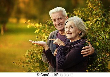 Nice mature couple  Woman pointing with finger