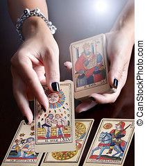 Hands Performing Tarot Card Reading - Female Hands...