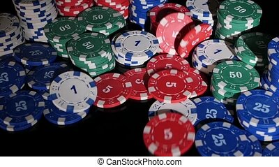 many poker chips falling on a black background. 2 pack. Slow...