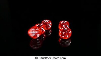 Throwing red dice on a black background. 2 pack. Slow motion.