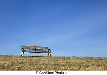 Empty Bench With Blue Sky