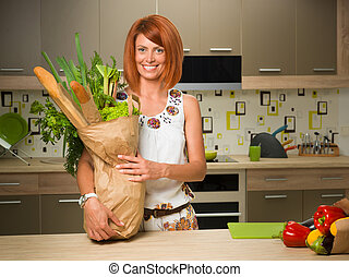 happy woman holding bag with groceries