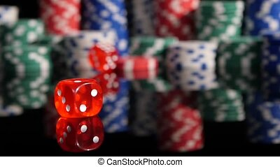 Throwing red dice on the background of poker chips. 3 pack....